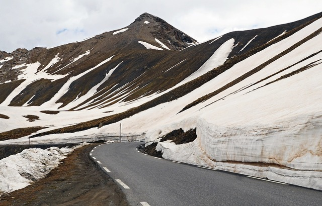 High alps pass road snow reste.
