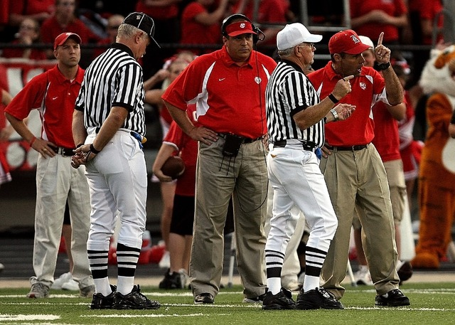 High school football confrontation football coach, people.