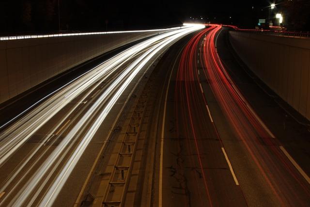 Highway night lights, transportation traffic.
