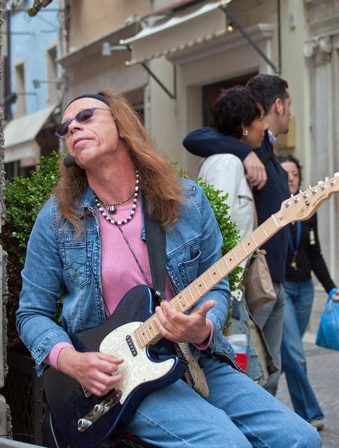 Hippie guitarist street musician.