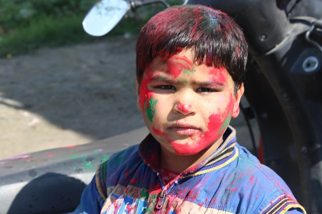 Holi children festival, emotions.