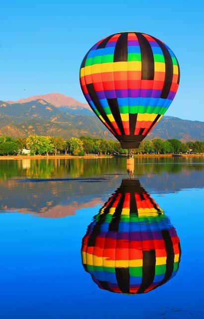 Hot air balloon reflection pikes peak, nature landscapes.
