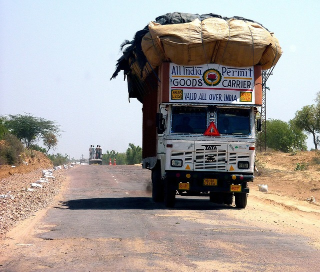 India overloaded truck, transportation traffic.
