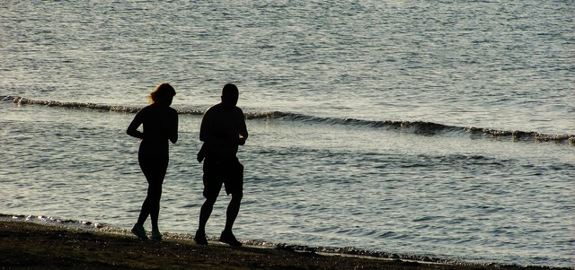 Jogging couple beach, travel vacation.