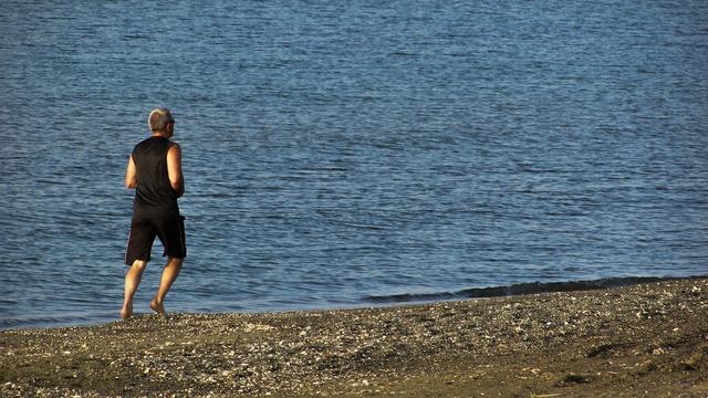 Jogging man beach, people.