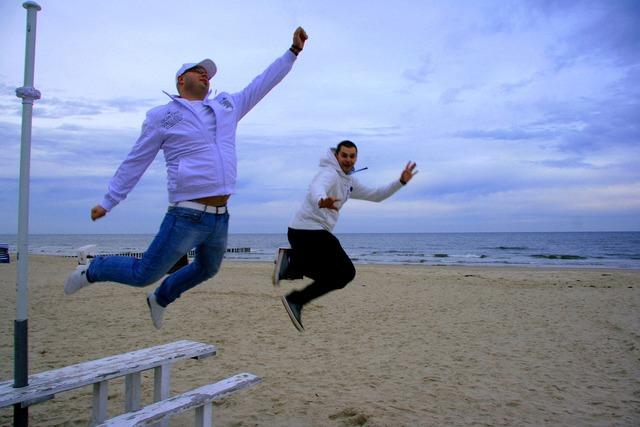 Jump teamwork sandy, travel vacation.