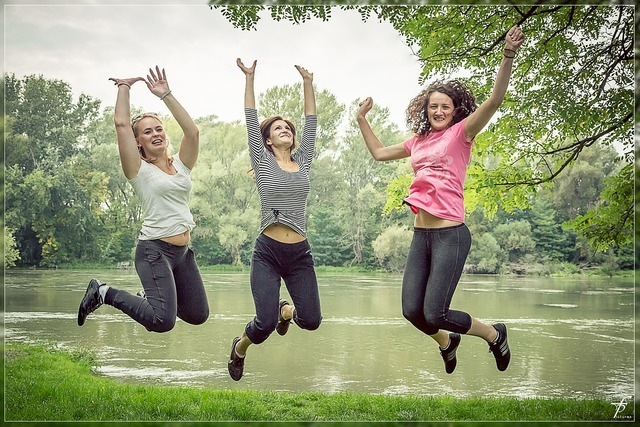 Jumping happy people female, beauty fashion.
