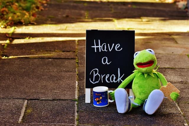 Kermit cup drink coffee.