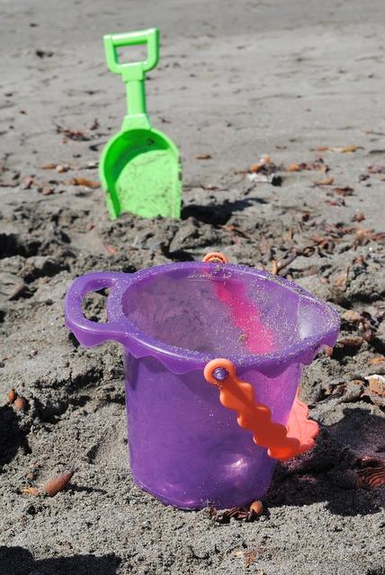 Kids play beach sandcastle, travel vacation.