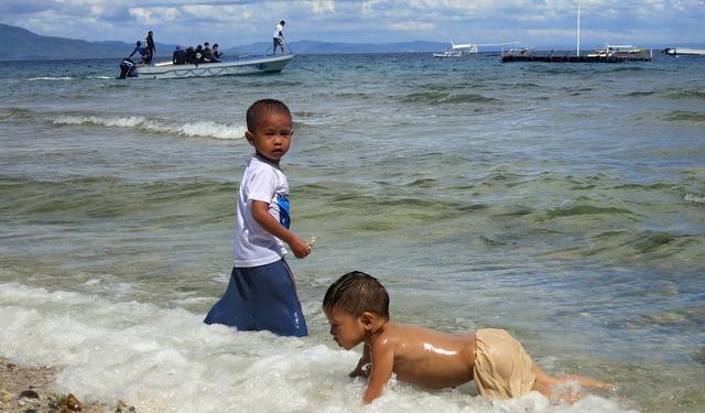 Kids playing beach, travel vacation.