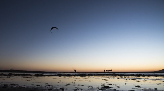 Kite surf rate sunset, travel vacation.