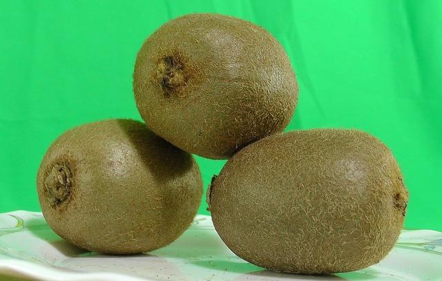 Kiwi fruit green background, food drink.