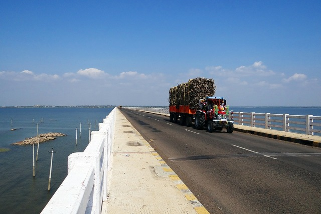 Krishna river bridge tractor, transportation traffic.