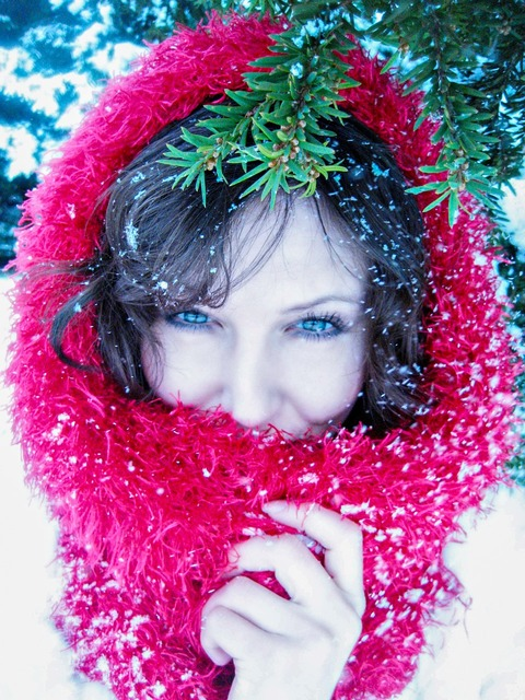 Lady in red in the snow snowfall, beauty fashion.