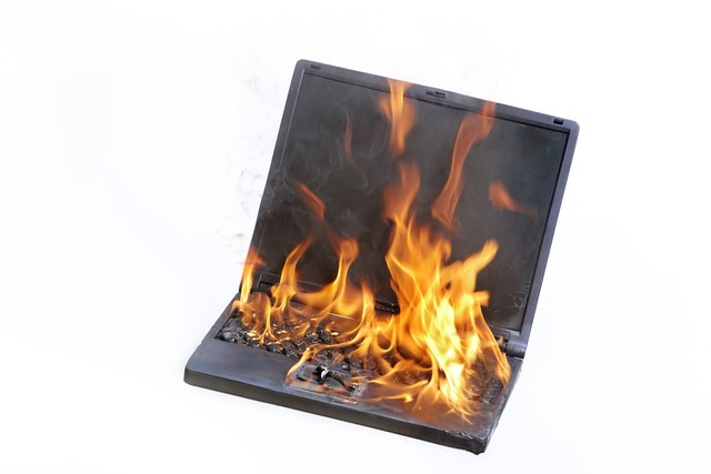 Laptop burning fire.