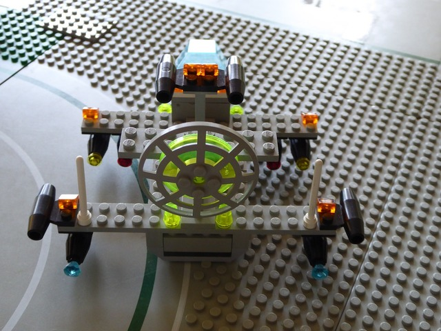 Lego blocks assembled flying object, architecture buildings.