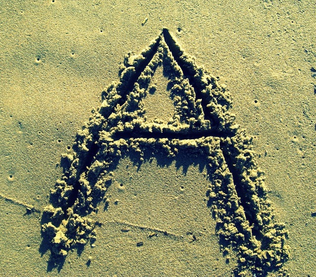 Letter a sand stick, travel vacation.