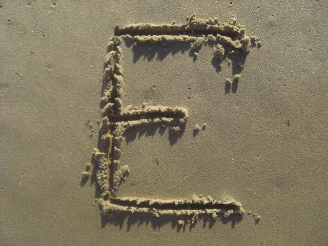Letter e sand stick, travel vacation.