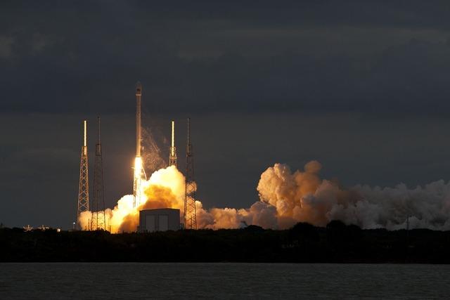 Lift-off night rocket launch, transportation traffic.