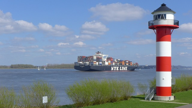Lighthouse container ship river.