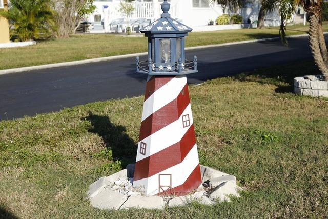 Lighthouse sailor garden figure.