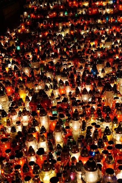Lights candles all saints day.