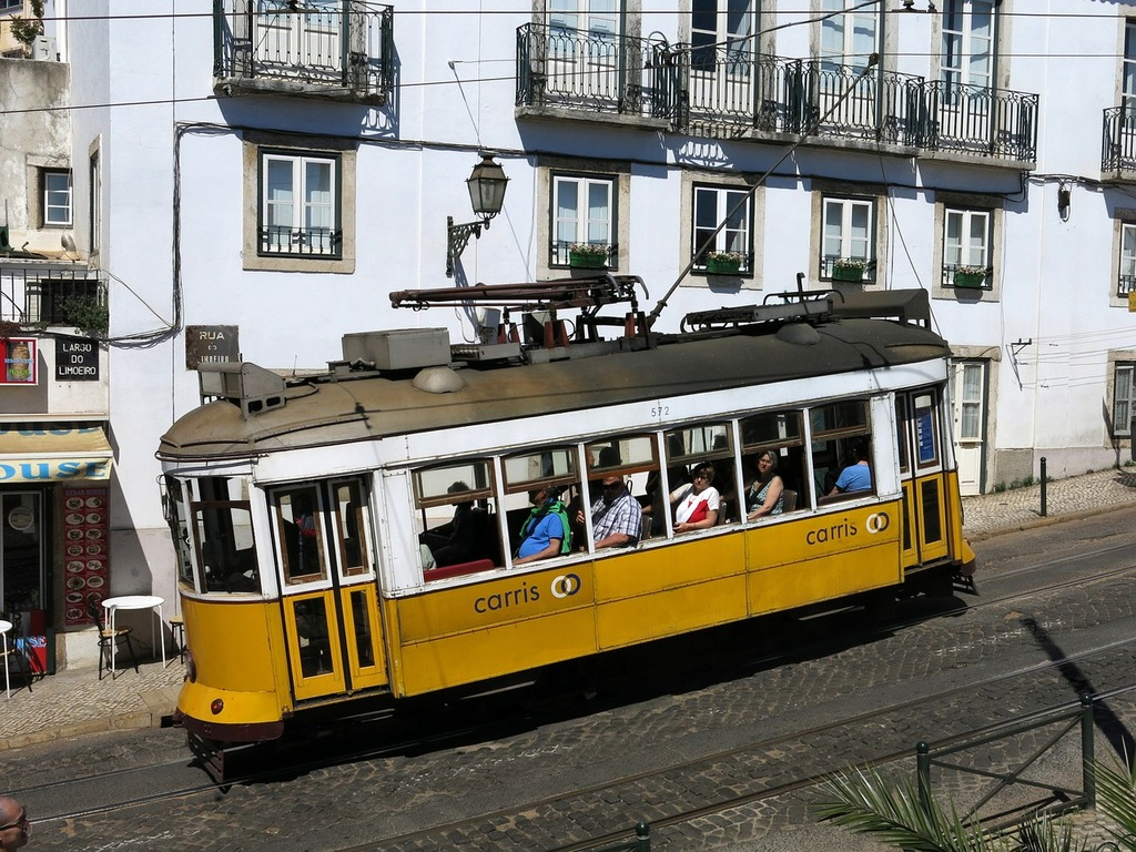 Lisbon old town tram, transportation traffic.