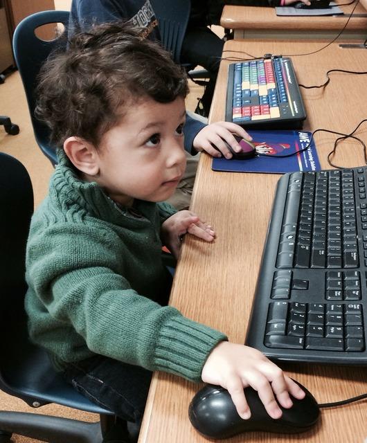 Little boy little techie boy with computer.