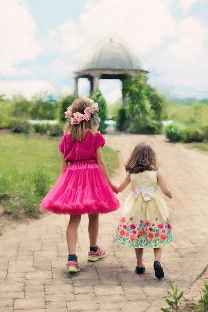 Little girls walking summer outdoors.