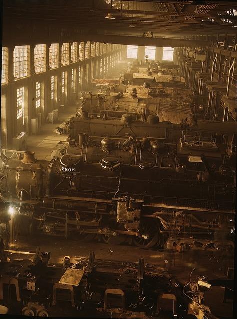 Locomotive shop railroad engines, architecture buildings.