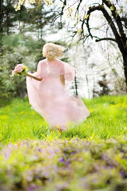 Lovely woman pink dress running, beauty fashion.