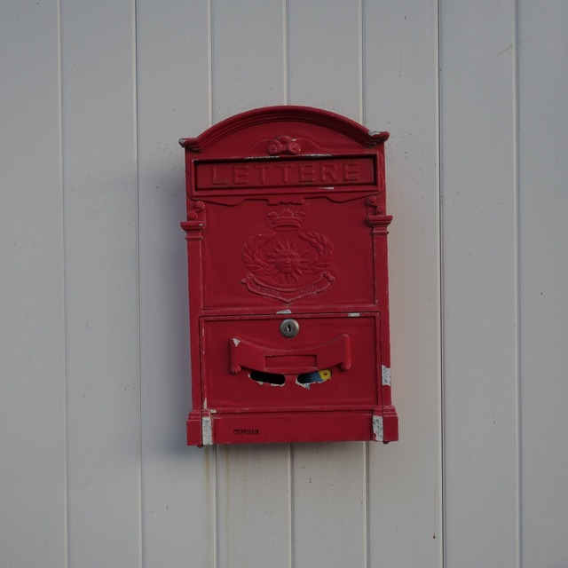 Mailbox red post.