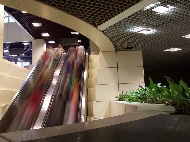 Mall escalator lifestyle, people.