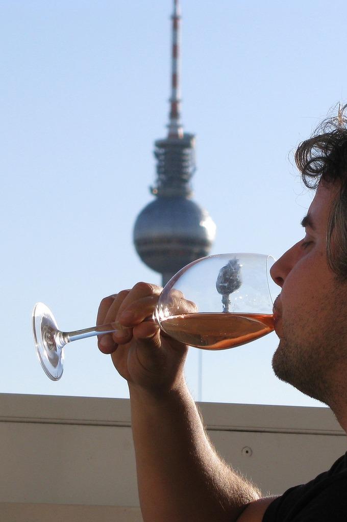 Man drinking wine, people.