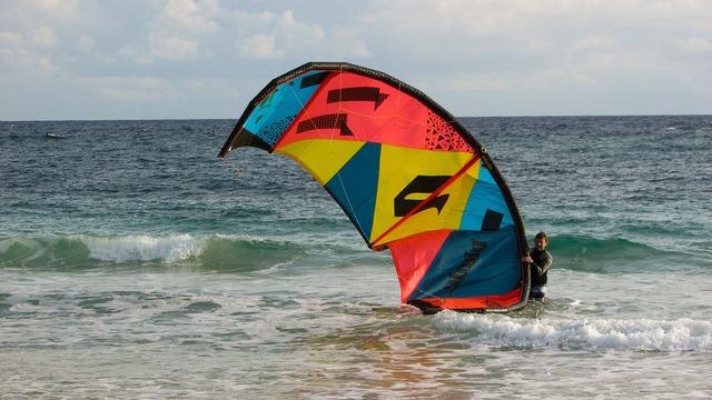 Man with kyte kite kite surfing, sports.