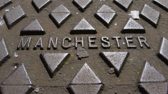 Manchester manhole cover metal, industry craft.