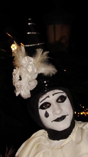 Mask make up street theater.