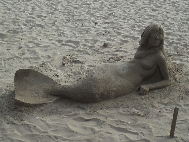 Mermaid sand sculpture, travel vacation.