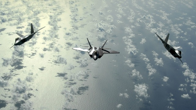 Military aircraft formation f-22.