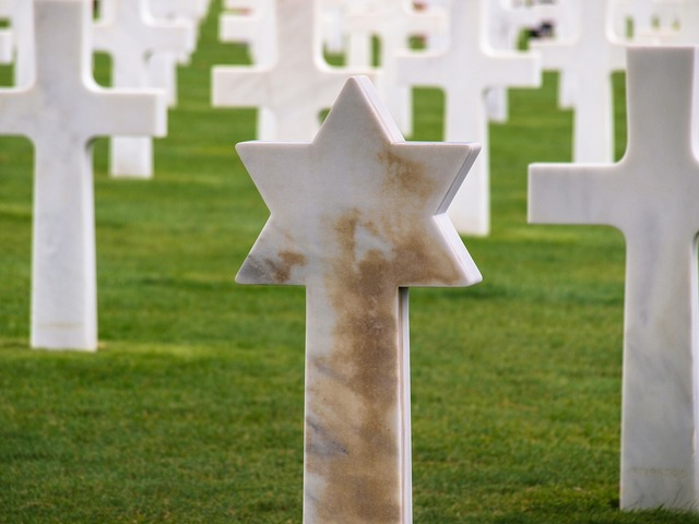 Military cemetery crosses star of david.