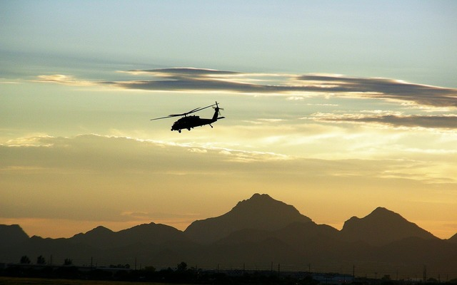 Military helicopter flying dusk.