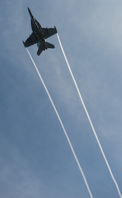 Military jet airplane flying.