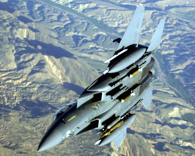 Military jet mountains f-15.