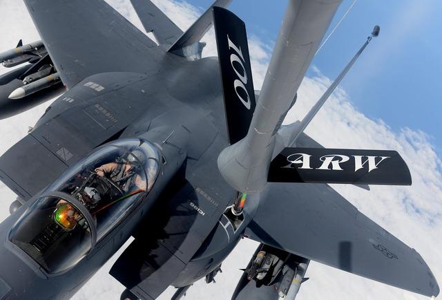 Military jet refueling flight.