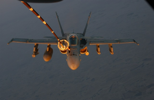 Military jet refueling inflight.