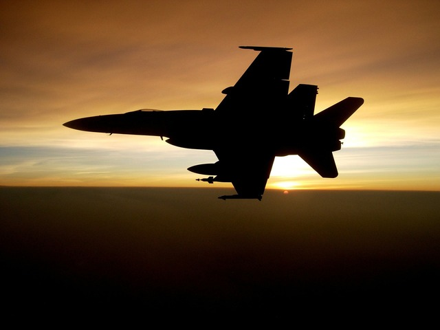 Military jet silhouette flying, travel vacation.