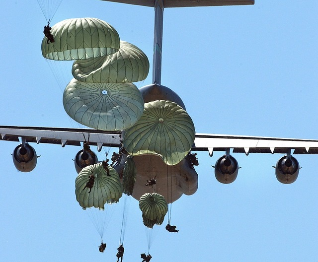 Military paratroopers airborne parachuting.