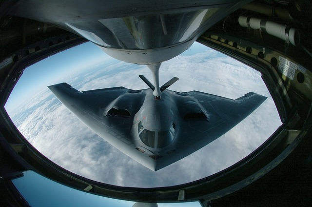 Military stealth bomber refueling, transportation traffic.