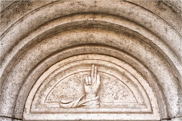 Modena symbol bas relief, religion.