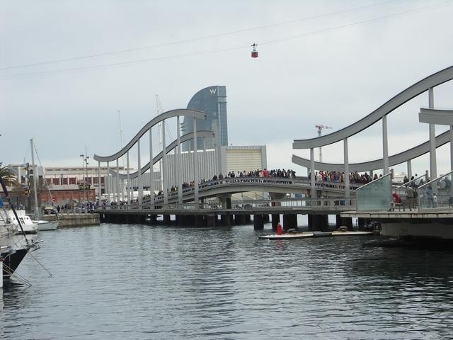 Modern bridge barcelona port, people.